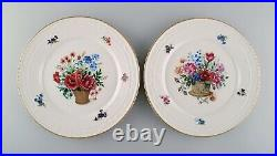 KPM, Berlin. Two antique porcelain plates with hand-painted flower baskets