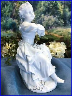 KPM Berlin White Porcelain Lassie with a Flower Basket in Blanc de Chine