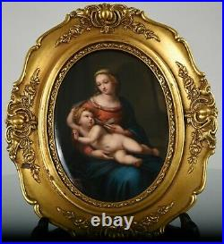 KPM framed porcelain plaque of Virgin Mary with halo holding Child with halo
